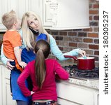 Small photo of Overwhelmed and frustrated Mom in the kitchen