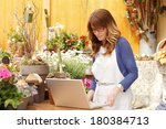 small flower shop owner working ... | Shutterstock . vector #180384713