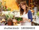 beautiful flower shop owner... | Shutterstock . vector #180384833