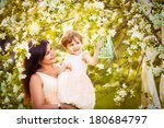 happy woman and child in the... | Shutterstock . vector #180684797