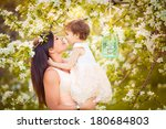 happy woman and child in the... | Shutterstock . vector #180684803