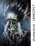 Small photo of American Indian warrior, chief of the tribe. man with feather headdress and tomahawk