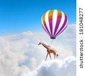 giraffe flying high in sky on... | Shutterstock . vector #181048277