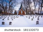 Snow Covered Cemetary At The...