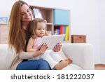 mother with baby using digital... | Shutterstock . vector #181222037