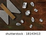 few diamonds over leather background and gauge - stock photo