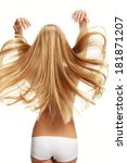 Small photo of Unbind hair / studio photography of young girl with healthy long hair - isolated on white background