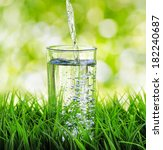 glass of water on nature... | Shutterstock . vector #182240687