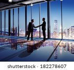 businessmen shaking hands with... | Shutterstock . vector #182278607