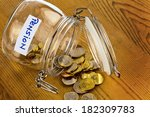 gold coins in a jam jar. the... | Shutterstock . vector #182309783