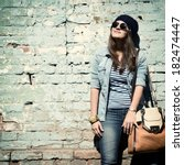 beautiful cool girl in hat and... | Shutterstock . vector #182474447