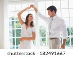 Loving Young Couple Dancing At...