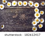 flowers on wooden background | Shutterstock . vector #182612417