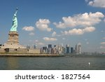 Statue of Liberty with Manhattan in background - stock photo