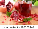 ripe pomegranates with juice on ... | Shutterstock . vector #182985467