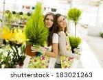 young women in flower garden | Shutterstock . vector #183021263
