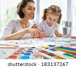 a happy family is painting | Shutterstock . vector #183137267
