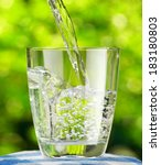 glass of water on nature... | Shutterstock . vector #183180803