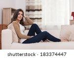 attractive woman relaxing on... | Shutterstock . vector #183374447