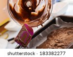 Chef Pouring Cake Batter In A...