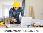 busy building contractor at... | Shutterstock . vector #183637673