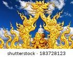Buddha Statue Against A Blue...