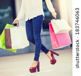 woman holding shopping bags at