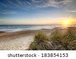 Sunset over sand dunes at Hengistbury Head beach near Bournemouth in Dorset