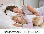 young girl and mother sleeping... | Shutterstock . vector #184136423