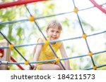 beautiful girl climbing on rope ... | Shutterstock . vector #184211573