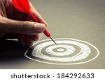 hand going to take dart into... | Shutterstock . vector #184292633