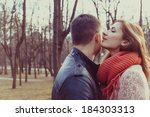 young happy couple hugging in... | Shutterstock . vector #184303313