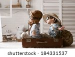 two boys in the form of an... | Shutterstock . vector #184331537