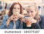 teenage girls drinking at bar | Shutterstock . vector #184375187