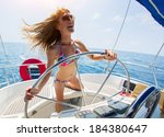 young laughing woman steering... | Shutterstock . vector #184380647