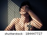 sad naked man sitting by the... | Shutterstock . vector #184447727