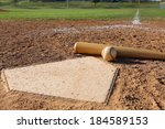 baseball and bat at home plate... | Shutterstock . vector #184589153