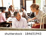two colleagues working at desk... | Shutterstock . vector #184651943