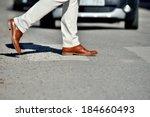 Man Taking The Step  Onto Zebr...