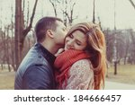 young happy couple hugging in... | Shutterstock . vector #184666457