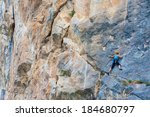 female climber on a cliff | Shutterstock . vector #184680797