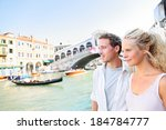 venice couple by rialto bridge... | Shutterstock . vector #184784777