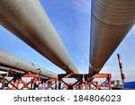 Small photo of Bridge pipeline aboveground heat main, lower shot on blue sky background