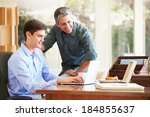 father and teenage son looking... | Shutterstock . vector #184855637