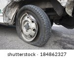 wrecked car tyre on the road
