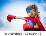 superhero kid against dramatic... | Shutterstock . vector #185034443