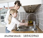 small girl in the kitchen with... | Shutterstock . vector #185423963