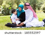 cheerful muslim family sitting... | Shutterstock . vector #185552597