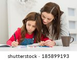 happy young mother helping her... | Shutterstock . vector #185899193