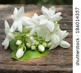Jasmine White Flower On Wooden...